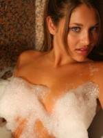 Lili gets topless in a bubble bath